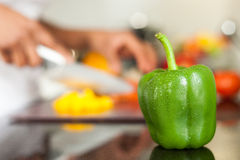 Fresh green pepper covered with water Stock Image