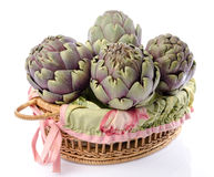 Fresh green purple artichokes in a basket Royalty Free Stock Photography
