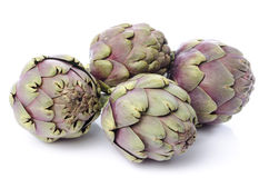 Fresh green purple artichokes. On white Stock Photography