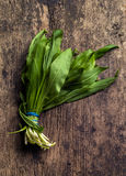Fresh green ramson leaves. On wooden table Stock Photo