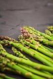 Fresh green raw asparagus. On dark background Royalty Free Stock Image