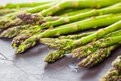 Fresh green raw asparagus. On dark background Royalty Free Stock Photo