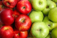 Fresh green and red apples. As background stock image