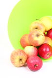 Fresh green, red apples in basket isolated Royalty Free Stock Images