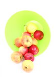 Fresh green, red apples in basket isolated Stock Photography