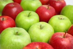 Fresh green and red apples. Closeup stock photos