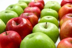Fresh green and red apples. Closeup royalty free stock images