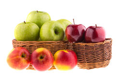 Fresh green and red apples in a wicker baskets Stock Image