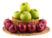Fresh green and red apples in a wicker baskets Stock Photos