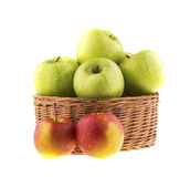 green and red apples in basket. fresh green and red apples in a wicker baskets stock image basket d
