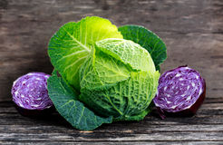 Fresh Green,Red cabbage. Fresh Green cabbage and slice of Red cabbage on old wooden table Royalty Free Stock Image