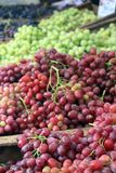 Fresh green and red Grapes for sale stock photos