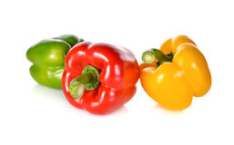 Fresh green, red, yellow bell pepper with stem on white backgrou Stock Photography