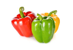 Fresh green, red, yellow bell pepper with stem on white backgrou Royalty Free Stock Photography