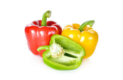 Fresh green, red, yellow bell pepper with stem on white backgrou Royalty Free Stock Image