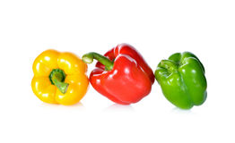 Fresh green, red, yellow bell pepper with stem on white backgrou Royalty Free Stock Photo