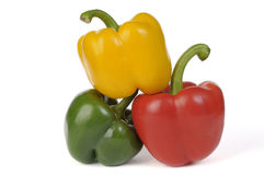 Fresh green, red and yellow paprika. Tri-color peppers, green, red and yellow on a white background royalty free stock image
