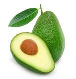 Fresh green ripe avocado and slice Royalty Free Stock Photography