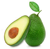 Fresh green ripe avocado and slice Stock Images