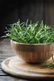 Fresh green rosemary in the wooden bowl Royalty Free Stock Image