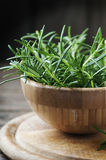 Fresh green rosemary in the wooden bowl Stock Photography