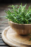 Fresh green rosemary in the wooden bowl Royalty Free Stock Photos