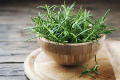 Fresh green rosemary on the wooden table Royalty Free Stock Photography