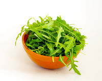 Fresh green Rucola salad in bowl Stock Photos