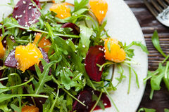 Fresh green salad with arugula and beets Royalty Free Stock Photo