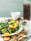 Fresh green salad with arugula, yellow tomatoes, olives, grapes Royalty Free Stock Photos