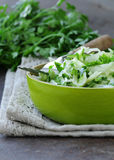 Fresh green salad with cabbage (coleslaw), cucumber and parsley Royalty Free Stock Photo