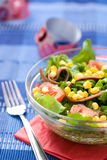 Fresh green salad with corn and anchovy. In a bowl Stock Image
