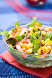 Fresh green salad with corn and anchovy. In a bowl Stock Photos