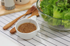 Fresh green salad and dressing Royalty Free Stock Image