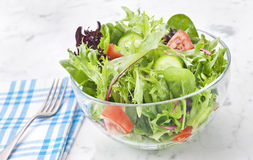 Fresh Green Salad Healthy Food. A fresh green salad with fork and napkin on whie marble Royalty Free Stock Photos