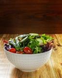 Fresh green salad mix in white bowl Royalty Free Stock Image