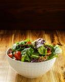 Fresh green salad mix in white bowl Royalty Free Stock Photos
