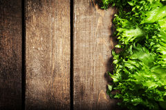 Fresh green salad over wooden background - healthy or vegetarian Royalty Free Stock Photography