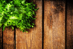 Fresh green salad over wooden table with copyspace for your text Royalty Free Stock Photography