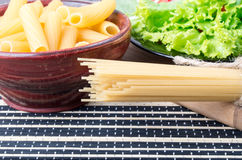 Fresh green salad, pasta and spaghetti closeup Royalty Free Stock Photography