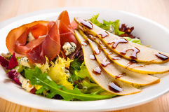 Fresh green salad with pears, jamon Royalty Free Stock Images