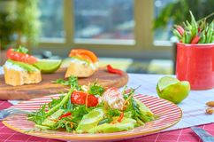 Fresh green salad with shrimps and poached egg royalty free stock photography
