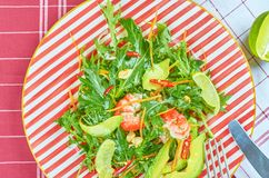 Fresh green salad with shrimps and poached egg royalty free stock photos