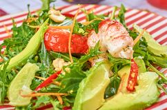 Fresh green salad with shrimps and poached egg stock image