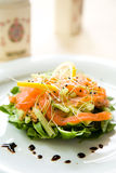Fresh green salad with smoked salmon,avocado and l. Emon in a plate Royalty Free Stock Image