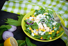Fresh green salad with sorrel. Cucumber and eggs, greek yogurt and  olive oil royalty free stock image