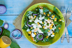 Fresh green salad with sorrel. Cucumber and eggs, greek yogurt and  olive oil Royalty Free Stock Photo