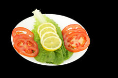 Fresh green Salad with tomato, lemon and lettuce Stock Photos