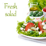 fresh green salad with vegetables and feta and ingredients Royalty Free Stock Photo
