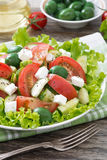 Fresh green salad with vegetables and feta, vertical Stock Photo